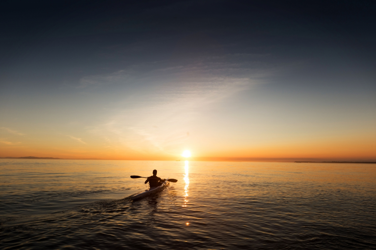 man-paddling-in-kayak-and-canoe-on-the-ocean-during-the-sunset-success quote